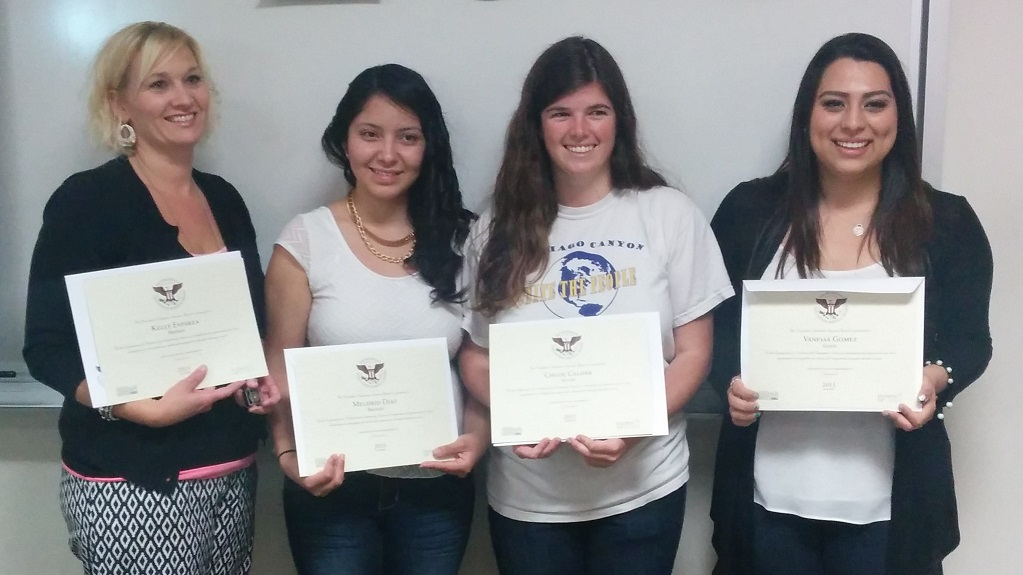 Students Holding Awards