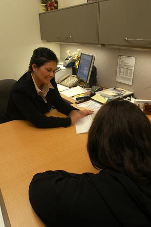 Female counselor talking to a female student