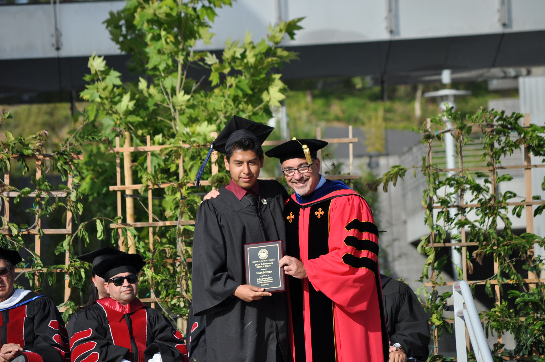 Irvin Medina (Class 2013 with Dr. John Hernandez recieving the Dean R. Strenger Service Award)