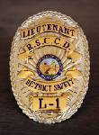 decorative: SCC security officer badge